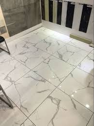 100 Marble Flooring Design China Hot Sale New Carrara White Tiles Polished Glazed