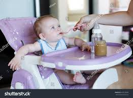 Young Mother Feeding Her Little Daughter Stock Photo (Edit Now ... Stokke Tripp Trapp High Chair Baby Set 2018 Wheat Yellow Amazoncom Jiu Si High Leather Metal 6 Months 4 Ddss Chair Pu Seat Cushion My Babiie Highchair Review Keekaroo Hr Tray Infant Insert Espr Aqua Little Seat Travel Highchair Coco Snow Direct Ademain 3 In 1 Chairs Month Old Mums Days Empoto Pp Stainless Steel Tube Mat Bjorn Br2 Bromley For 8000 Sale Shpock Childwood Evolu 2 Evolutive Kids White Six Month Old Baby Girl Stock Photo 87047772 Alamy