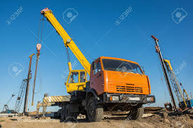 Mobile Truck-mounted Crane Operating At Construction Site Stock ...