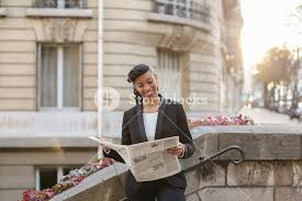 Young Mulatto Reporter Looking At Cam With Newspaper On Balcony Near High Building Pretty Woman Looks Successful And Has Ponytail Hairstyle Black
