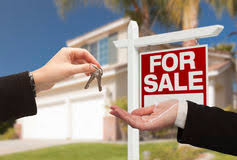 Agent Handing Over House Keys In Front Of New Home Royalty Free Stock Image
