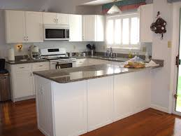 Painting Oak Kitchen Cabinets With White Chalk Paint Color Plus Microwave Shelf Under Mounted Cabinet And Marble Countertop Brown Hardwood Floor Tiles