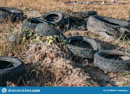 100 Used Truck Tires Pill Of Garbage From Old Rubber Wheel On Meadow