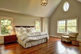 traditional master bedroom with high ceiling chandelier in water