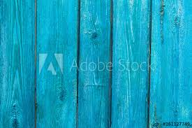 Vintage Wooden Texture Of An Old Fence Painted Blue Vertical On Background