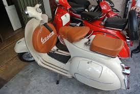 Cream Color Vespa With Tan Seats