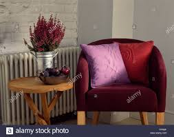 Small Rustic Table Beside Red Tub Chair Stock Photo: 245581827 - Alamy Cheshire Rustic Oak Small Ding Table Set 25 Slat Back Wning Tall Black Kitchen Chef Spaces And Polyamory Definition Fniture Chairs Tables Ashley South Big Lewis Sets Cadian Room Best Modern Amazoncom End Wood And Metal Industrial Style Astounding Lots Everyday Round Diy With Bench Design Ideas Chic Inspiration Rectangle Mhwatson 2 Pedestal 6 1 Leaf Drop Dead Gorgeous For Less Apartments Quality Images Target Centerpieces Mid