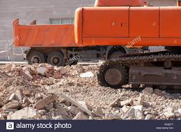 Track Excavator And Dump Truck Over Loads Of Brick Rubble Debris ... Large Track Hoe Excavator Filling A Dump Truck With Rock And Soil Train Strikes Dump Truck In Taylorsville 2015 Rayco Rct80 New Kubota Diesel Made In Usa Two Trains Hit Killing Driver Morooka Mst1100 Crawler Carrier 5 Ton Capacity Haul Wikipedia Jellydog Toy Tumble Set Car Twister Electric Injured When Flips Near Weymouth Train Tracks News Tracked All Nodwell At Pioneer Rentals Dumptruck