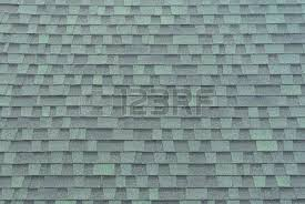 clean roof tiles background texture in regular rows stock photo