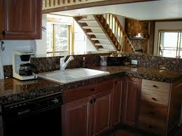 White Cabinets Dark Grey Countertops by Kitchen Wooden Kitchen Cabinets Mixed With Blue Grey Countertop In
