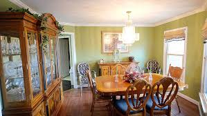 Light Green Walls With White Crown Molding Hardwood Floors And Oak Dining Room Set