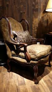 The Elegant Curves Of This Beautiful Accent Chair Give Its Rustic Style A Softer Edge