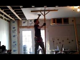 Hanging Drywall On Ceiling Or Walls First by That Is How It Is Done Sheetrock To Ceiling With Two Hands And A
