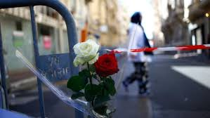 Roses Are Attached At A Barrier Near The Scene After Truck Attack In Nice Southern France Friday July 15 2016 AP Francois Mori