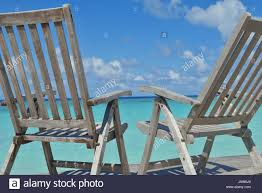 Two Chairs Beds In Forest On Tropical Beach With Blue Ocean ... Wooden Puppet On The Wooden Beach Chair Blue Screen Background Outdoor Portable Cheap Rocking Chairpersonalized Beach Chairs Buy Chairpersonalized Chairsinflatable Chair Product Coastal House Art Blue Sharon Cummings Tshirt Miniature Of A In Front Lagoon Hot Item High Quality Telescope Casual Sun And Sand Folding Bluewhite Stripe Version Stock Image Image Coastal Print Cat In A On The Stock Tourist Trip Summer Travel White Alexei Safavieh Fox6702c Bay Rum Na Twitteru Theres Rocking