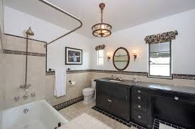 border tile with light gray walls bathroom contemporary and