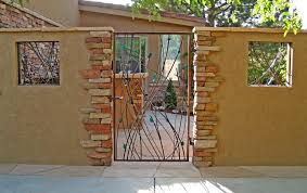 Custom Welded Metal Gate For Rustic Courtyard