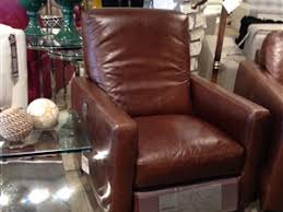 Natuzzi Swivel Chair Brown by Town And Country Leather Furniture Store