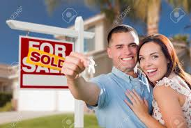 Mixed Race Excited Military Couple In Front Of New Home With House Keys And Sold