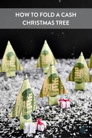 How To Fold Your Dollar Bills Into Cute Little Christmas Trees