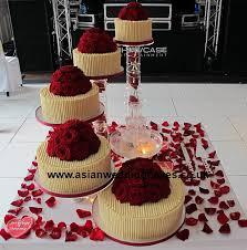 Chocolate spiral Style wedding cake 5 tier Spiral chocolate wedding cake Fresh Red roses on top of cakes White chocolate around cake