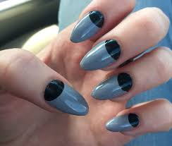 Light gray long almond shaped nails with black half moon design