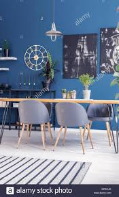 Black Paintings On Blue Wall With Gold Clock In Modern Dining Room ... Vig Fniture Modrest Kingsley Modern Black Rose Gold Ding Chair Of America Duarte Iii Crocodile Textured Zuo Elio Set 2 Antique Sets Glass Tops Bases Chairs Frame Pedestal Vintage European And Round Table Beautiful Leopard Print 6 Room Wooden Best Of 25 With Legs Ideas Design 100 Transformed Reality Daydream Meridian Karina The Classy Home Inspirational 50 And Dcor Inspiration For New Years Eve Nage Designs Patings On Blue Wall Gold Clock In Modern Ding Room