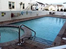 Pristine Condo 2pools Hot Tubs And Kiddie Pools Grills Eating Area
