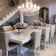 Sleek white table with ivory beige dining chairs top off the