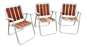 Redwood & Aluminum Folding Patio Lawn Chairs - Set Of 3 | Chairish Vintage Alinum Folding Redwood Wood Slat Lawn Chair Patio Deck Webbed Lawnpatio Beach Yellowwhite Table Tables Stainless Steel Ding Garden 2 Vintage Matching Alinum Webbed Sunbeam Lawn Arm Beach Chair Pair All Folding Mod Orange Patio Pair Of Chairs By Telescope Fniture Company For Sale At 1stdibs Retro Alinum Patio Fniture Ujecdentcom And Mid Century Vtg Blue Canvas Director How To Tell If Metal Decor Is Worth Refishing Diy 3 Outdoor Macrame A Howtos