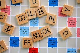Scrabble Tile Point Distribution by Do Scrabble Tiles In Other Languages Have Separate Tiles For