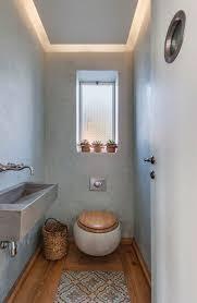 gäste wc gestalten klein rustikal holzboden toilettensitz
