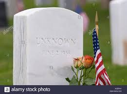 Memorial Day Graveside Decorations by Flowers And A U S Flag Decorate The Grave Of An Unknown Soldier