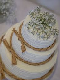 Wedding Cake With Butter Cream Icing And Flowers