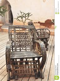 Wicker Armchair With Old Wall Background On Patio Stock Photo ...