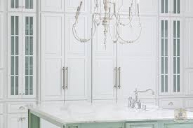 glass front kitchen cabinets whitewashed candle chandelier
