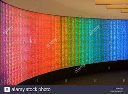 curved glass block brick wall with colored fluorescent lights at