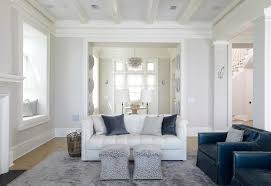 white and blue living room with window seat alcove cottage