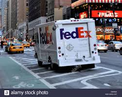 A FedEx Truck In New York City Stock Photo: 60613120 - Alamy Bloomberg Technology On Twitter Fedex And Volvo Are Trying Out New Ground Gives Update Macon Georgia Hub Other Projects Truck Turning Corner Stuck In Traffic During Day New Peterbilt Truck Tow To Desnation Youtube York September 28 2016 A Vehicle Is Seen In The Stock Its Delivery Route White Plains Brand Goes All Orange Who Delivers On Years Day Hours For Ups Amazon Fedex Haven Indiana Solannaforaco Man Hurled Racist Slurs Punch At Driverthen Died After He Photos Crashes Spilling Boxes Onto Highway Abc7nycom Loretta Bruyer Navajo 1st Woman Win Mexico Driving