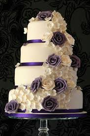Purple and white flowers and roses wedding cake