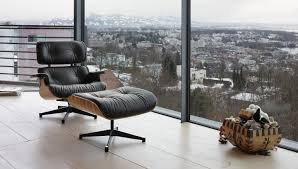 Vitra Vitra Lounge Chair Ottoman   Walnut, White Pigmented 12 Things You Didnt Know About The Eames Lounge Chair Why Are The Chairs So Darn Expensive Classic Chair Ottoman White With Black Base Our Public Bar Hifi Wigwam Vitra Walnut Black Pigmented Lounge Chair Armchairs From Architonic Version Pigmentation Nero 84 Cm Original Height 1956 Alinium Polished Sides Conran Shop X Departures Magazine