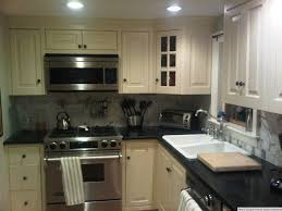 Free Standing Kitchen Cabinets Amazon by Light Cabinets Dark Countertops Ceramic Tile Fireplace Hearth