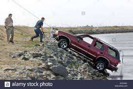 A Tow Truck Pulls A Chevy Blazer Out Of The Old River South Of Stock ...
