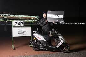 An Exhausted Masaru Abe Celebrates His 500 Kilometre Wheelstand