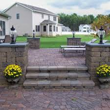 Installing 12x12 Patio Pavers by Professional Pavers Installation Services Buck Concrete