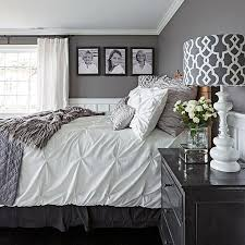 An Antique Bed Is Outfitted With Coverings From TMaxx Target And Z Gallerie In This Gray Bedroom
