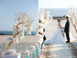 Modern Beach Wedding With Orchid Draped Branches Lining The Aisle
