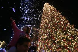 Lily Glasser 4 Reaches Out For Faux Snow At The Annual Christmas Tree Lighting