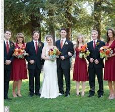 To Coordinate With The Bridesmaids Groomsmen Wore Burgundy Ties In Same Shade As Girls Dresses Womens Elaborate Bouquets Had A