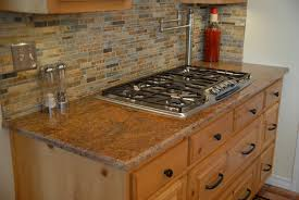 Backsplash Ideas For Dark Cabinets by Granite Countertop Kitchen Design With Dark Cabinets Tile